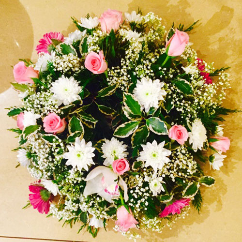 Simple round wreath with a mix of pink and white flowers funeral round wreath pink funeral wreath killorglin flowers mightylinksfo